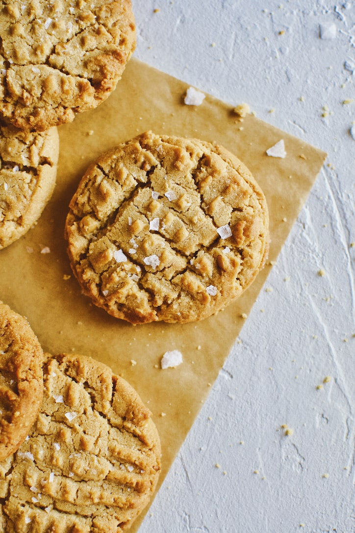 Crunchy Peanut Butter Cookies laid in a pile.