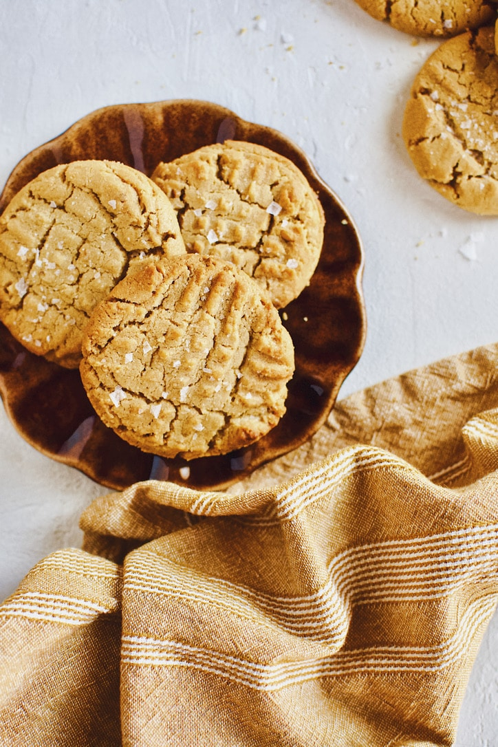 Three Crunchy Peanut Butter Cookies on a plate.