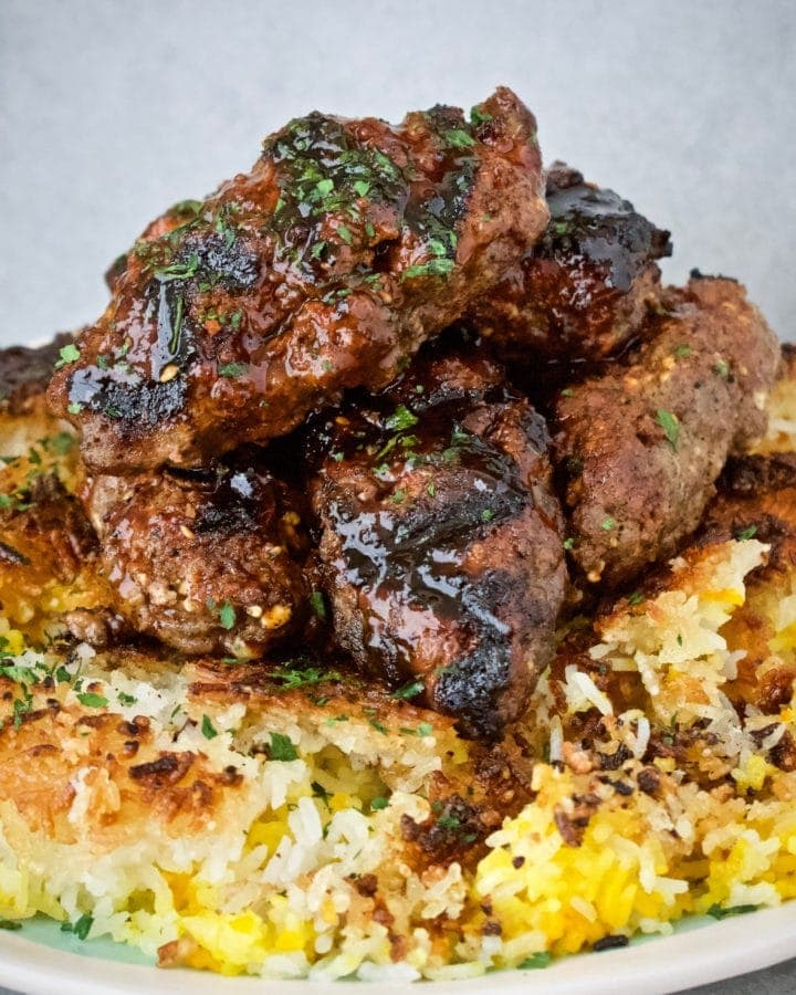 Beef Kefta meatballs on a bed of tahdig rice