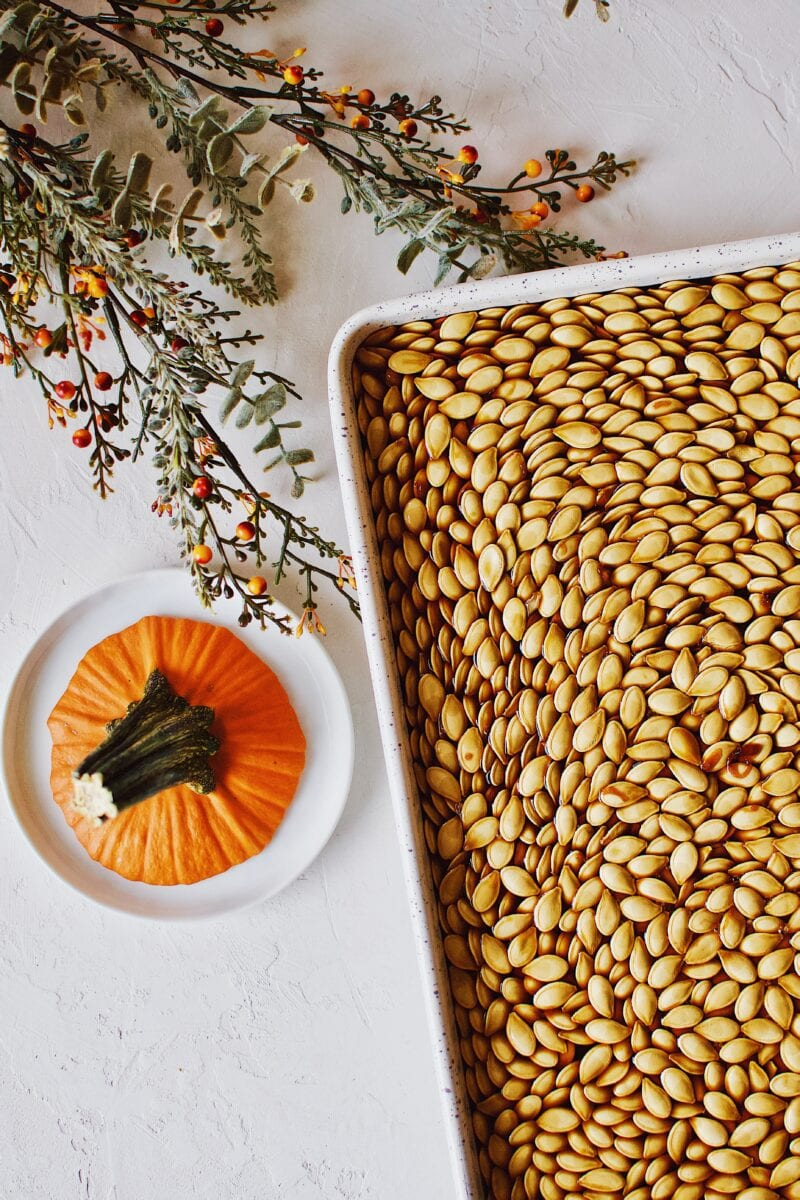 Soy Sauce Pumpkin Seeds soaked in soy sauce and on a sheet pan ready to eat.