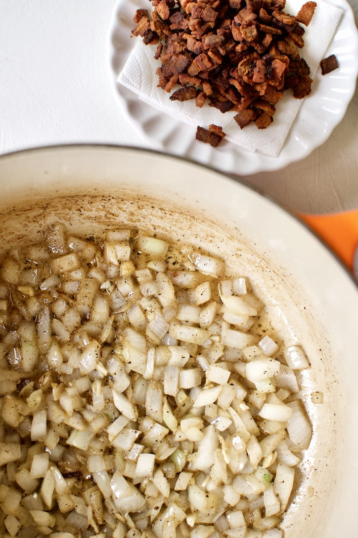 creating flavor in the bottom of the soup pot, cooking onions in the rendered bacon fat.