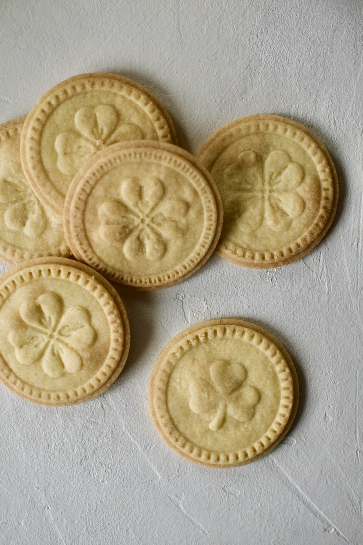 Irish Shortbread stamped with four-leaf clover and shamrocks on them.