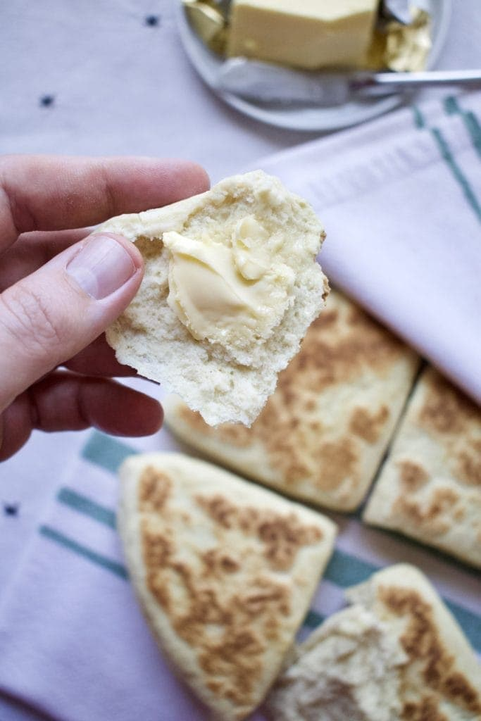Classic Irish Soda Bread with Irish butter on a piece.