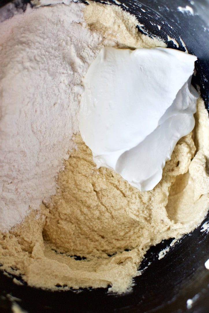 Adding the sour cream flour to the cake batter.