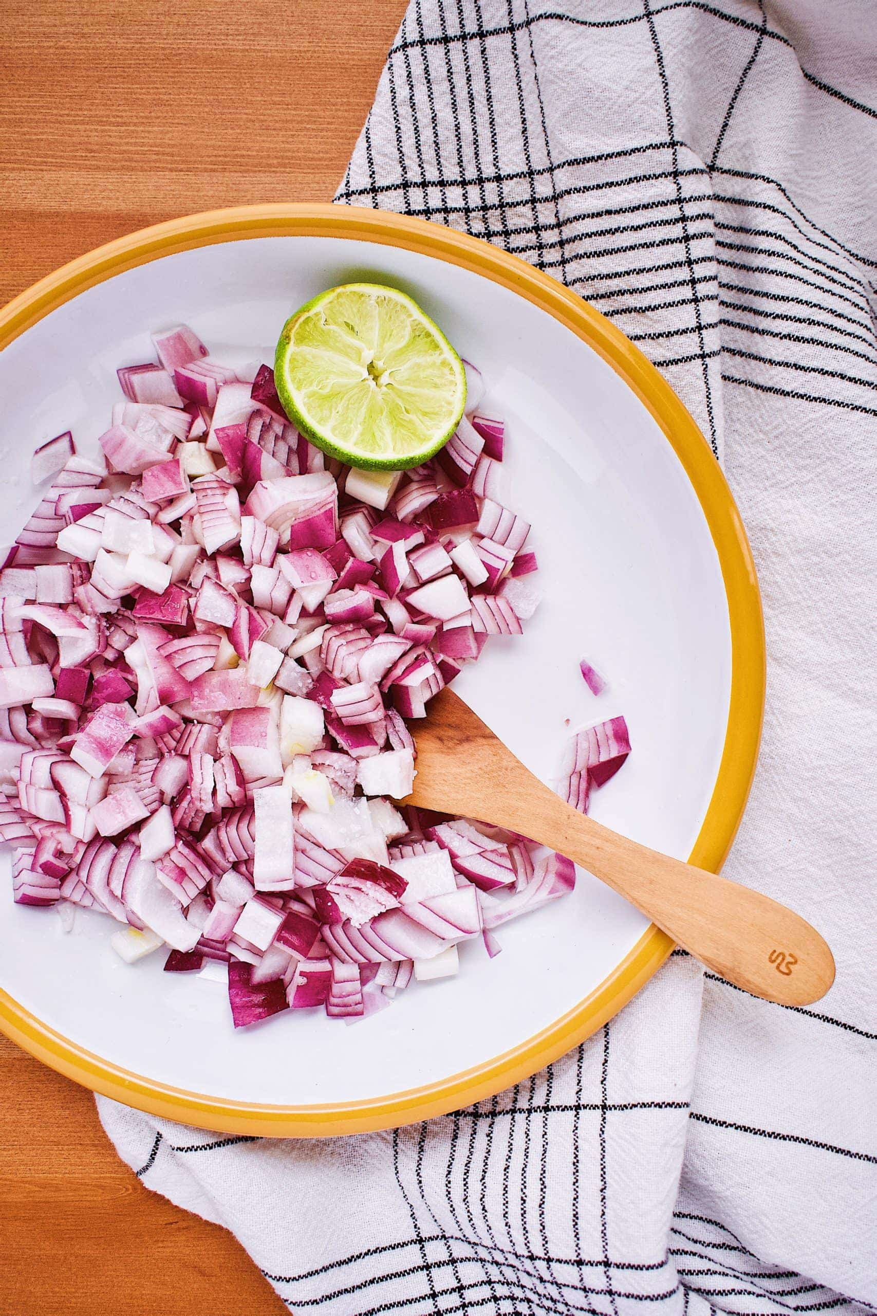 Diced red onion marinated in lime juice