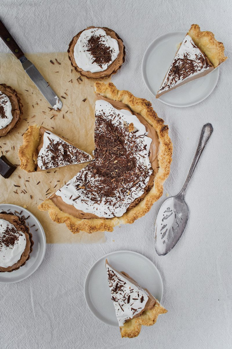 Joanna Gaines French Silk Pie that has been sliced, with tartlets around it