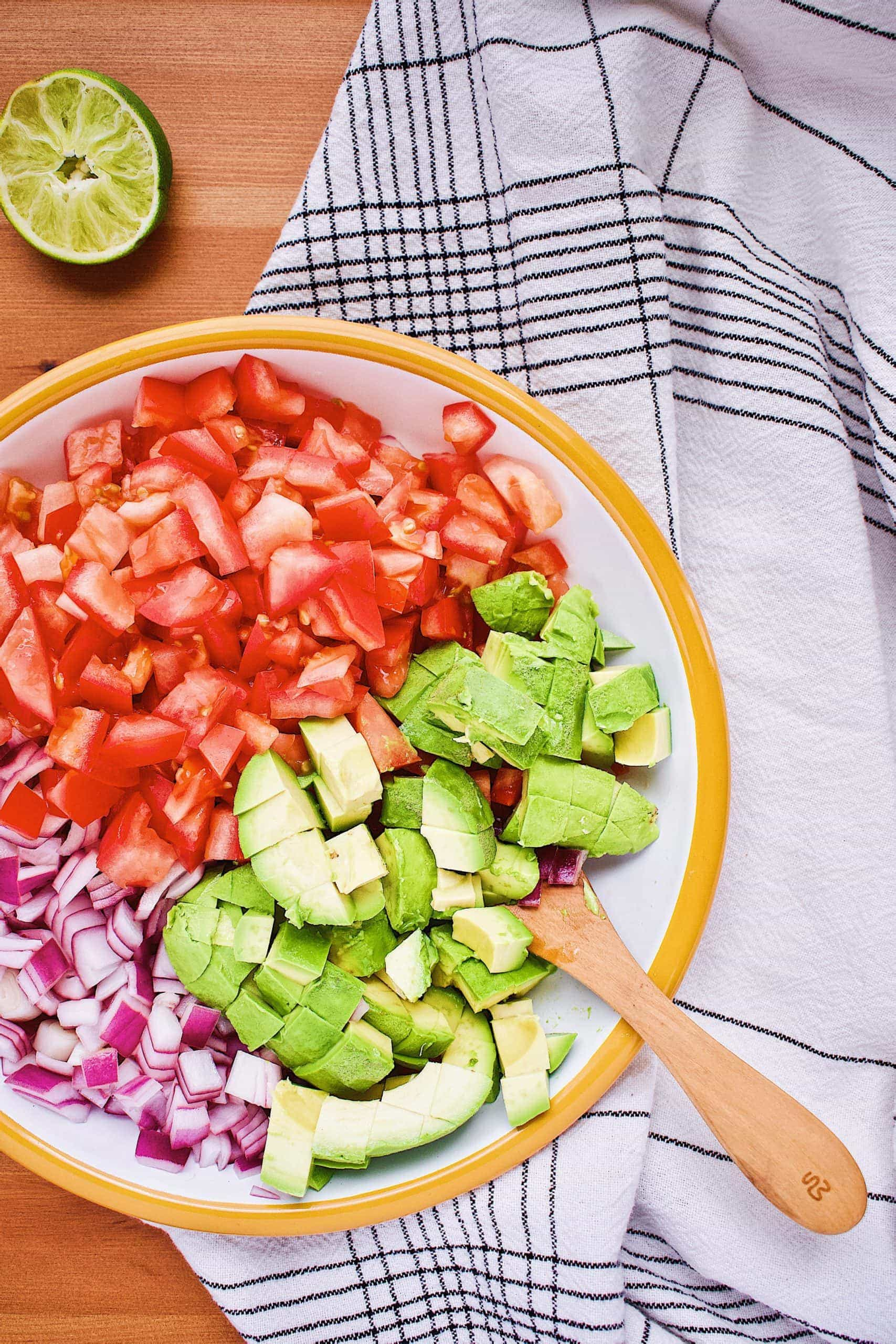 Avocado Salsa ingredients in a bowl ready to be mixed gently