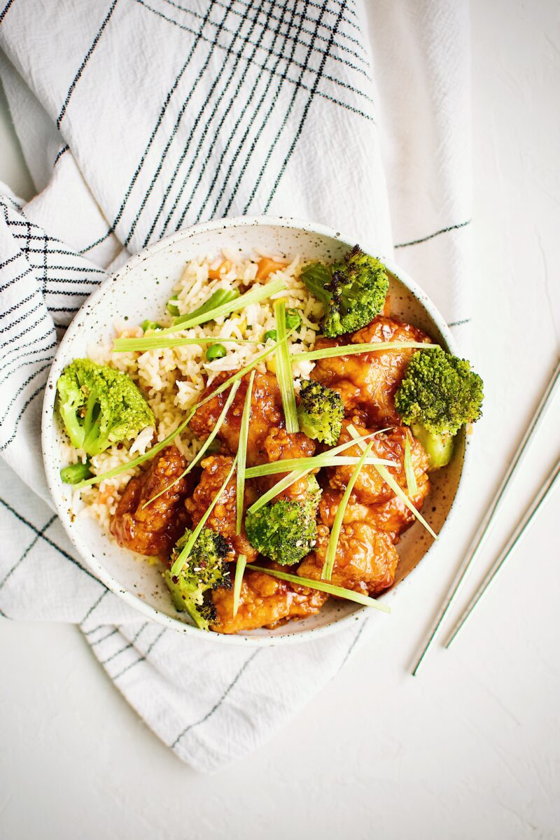 General Tso's Chicken served with fried rice and roasted broccoli