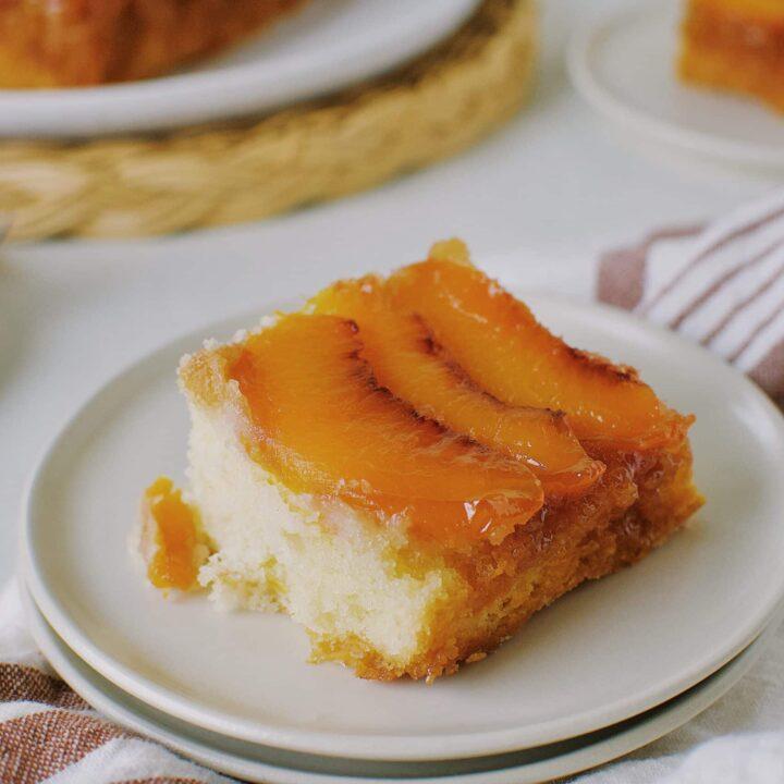 Peach Upside-Down Cake sliced on a plate.