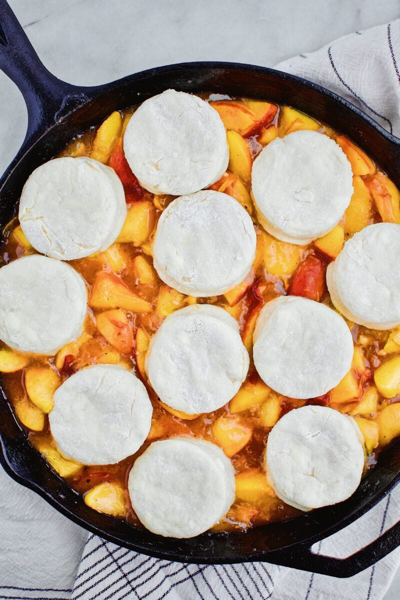 Skillet Peach Cobbler with Homemade Bisucits on top