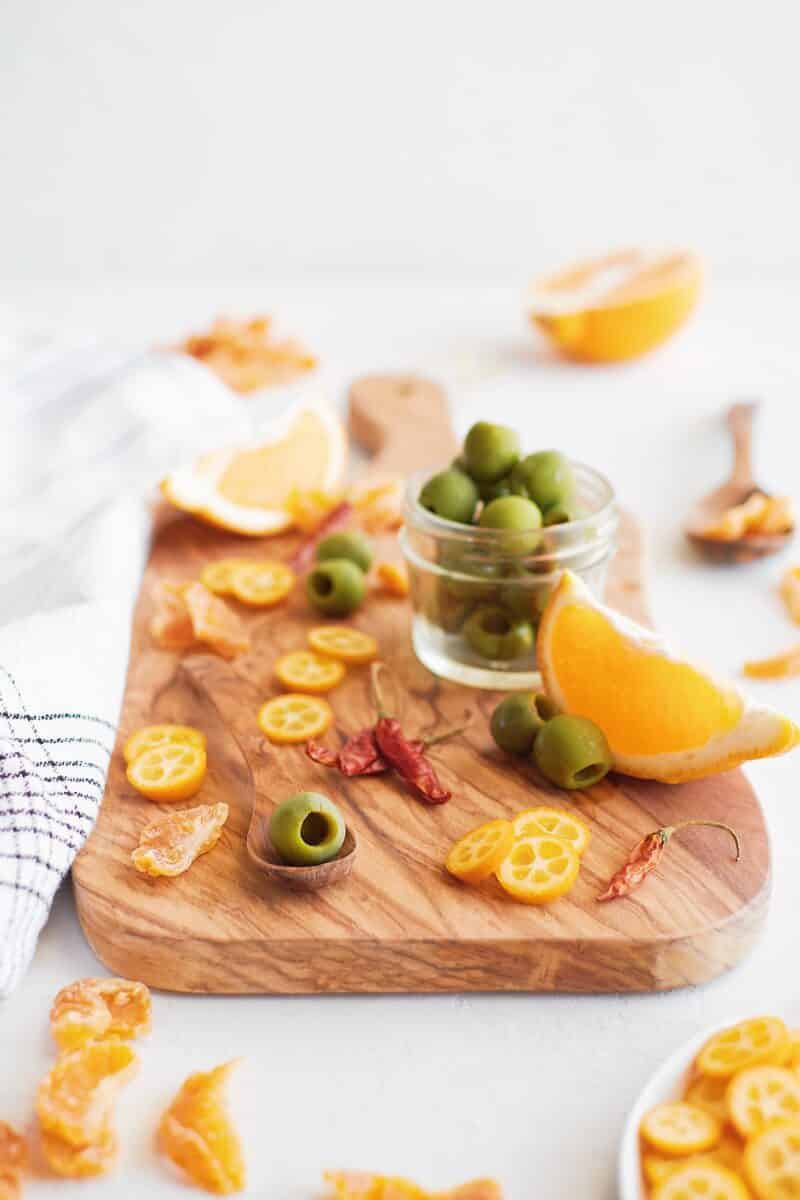 Ingredients needed for marinating olives with citrus and chiles