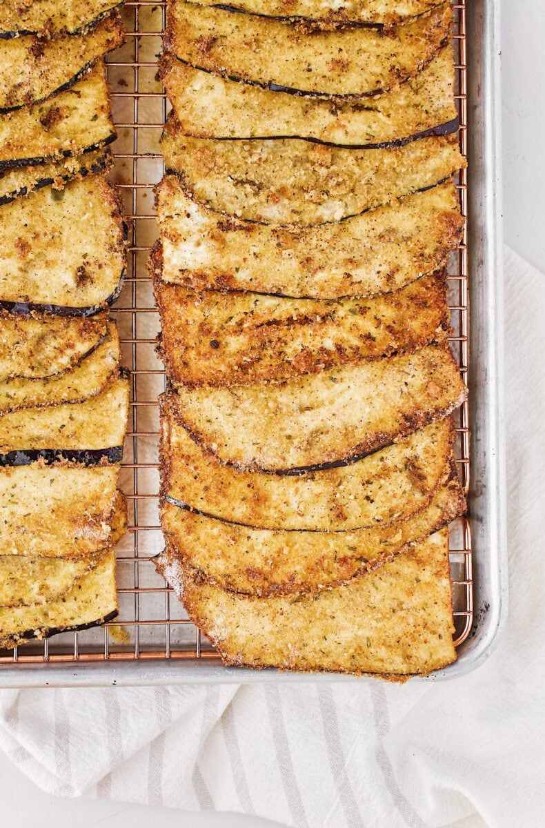 fried eggplant slices ready to be rolled