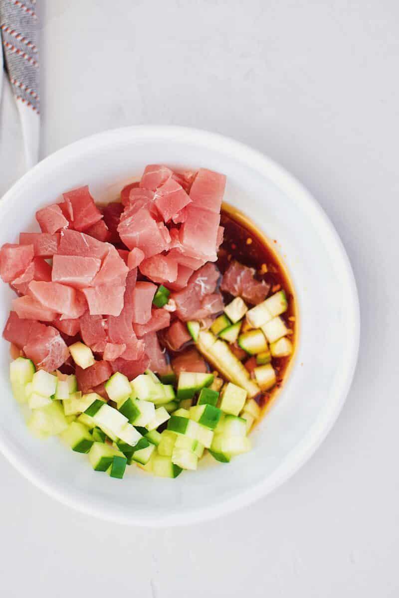 Tuna, cucumber, and poke marinade in a bowl