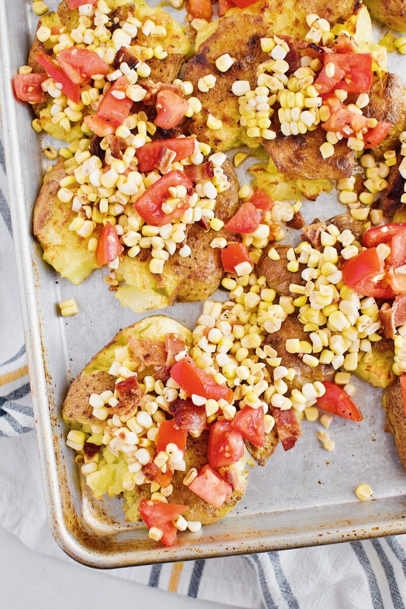 Smashed potatoes with corn salad on top