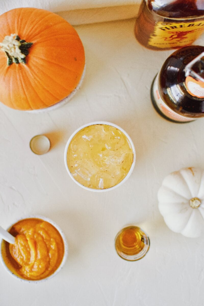 spiked sparkling pumpkin juice with pumpkin spice ginger beer and cinnamon whisky.