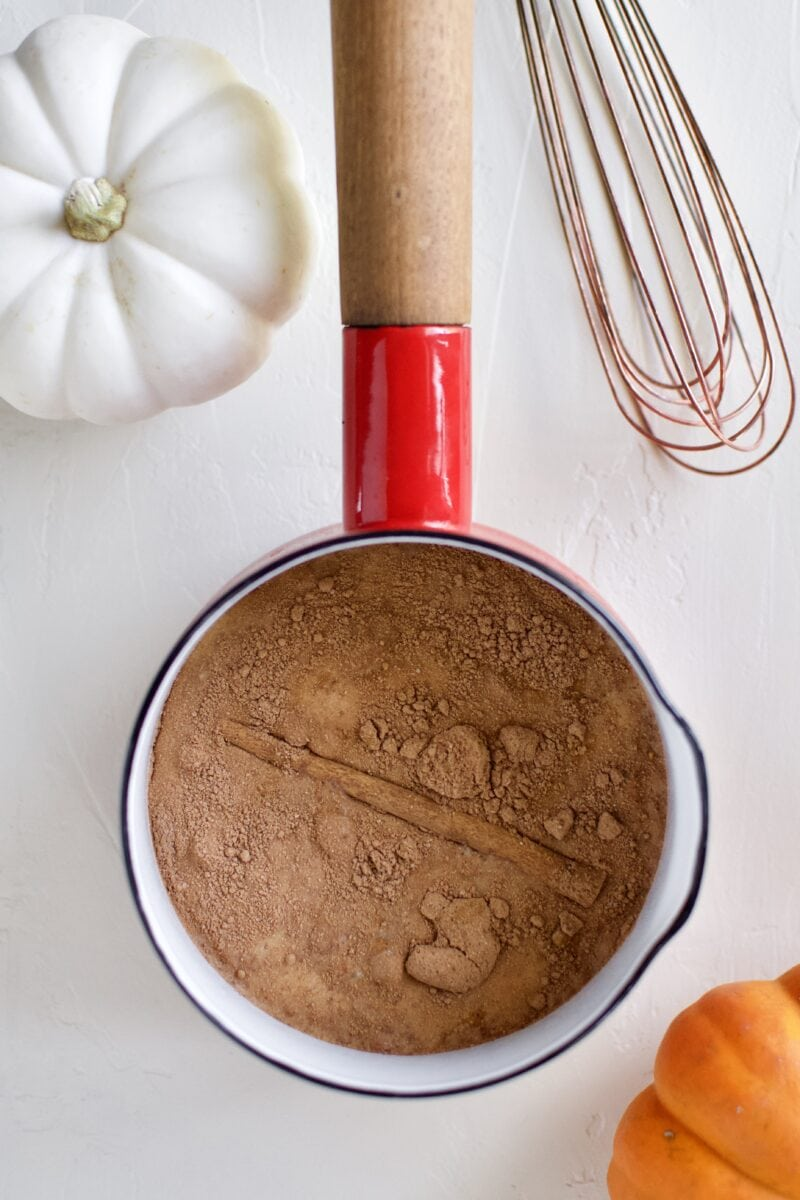 Pumpkin Spice Hot Chocolate ingredients in a saucepan