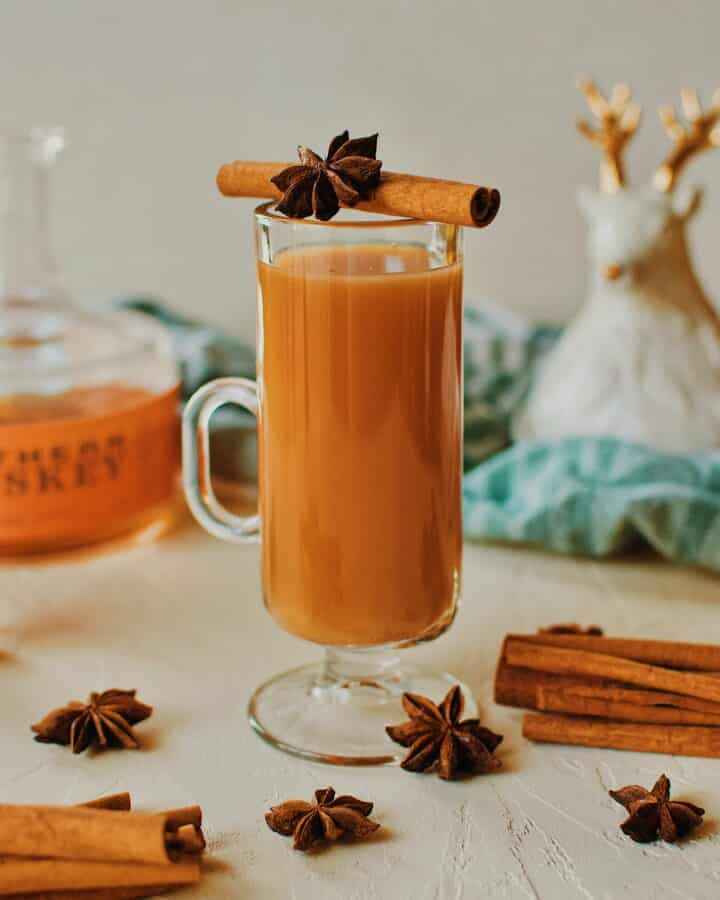 Winter Whiskey Wassail garnished with a cinnamon stick and star anise pod.