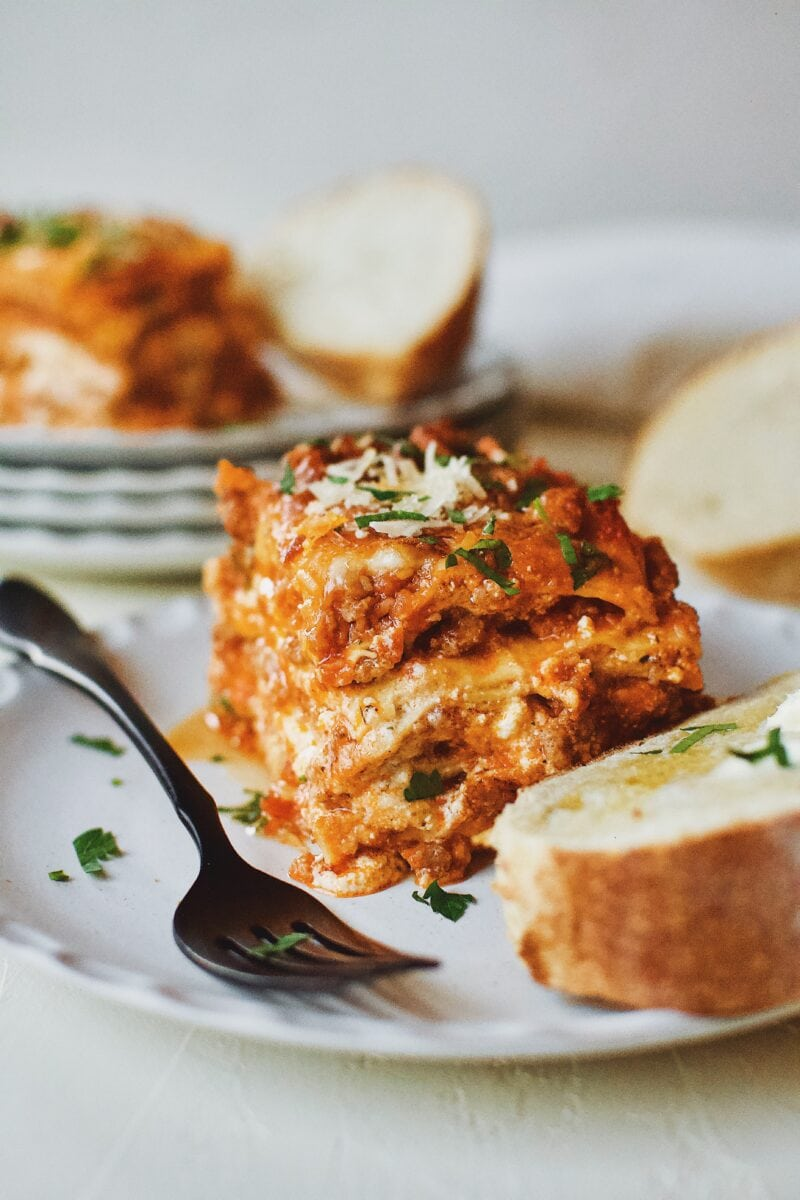 Homemade Lasagna served with toasted bread and butter.