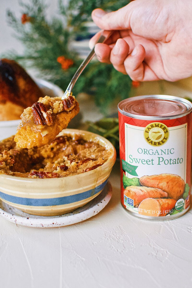 Great Aunt Sally's Sweet Potato Soufflé right out of the oven with a can of Farmers Market Foods Sweet Potato puree next to it.