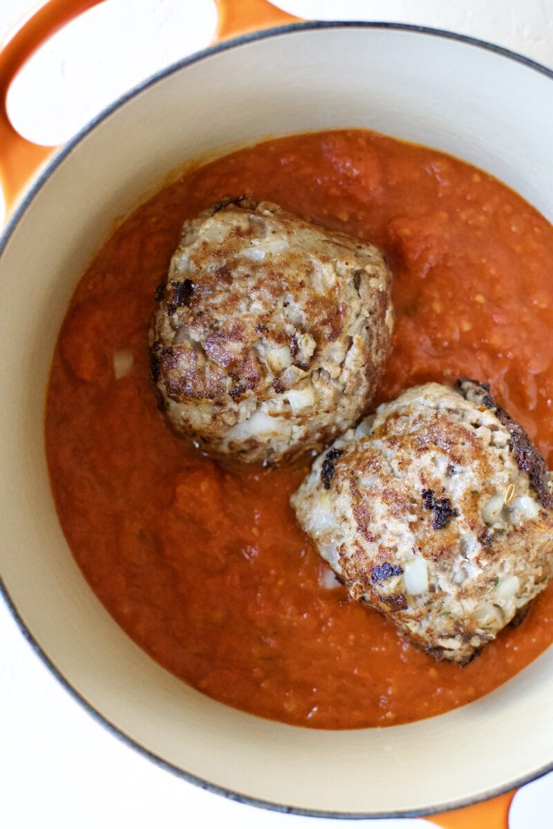 Roasted Giant Meatballs in tomato sauce.