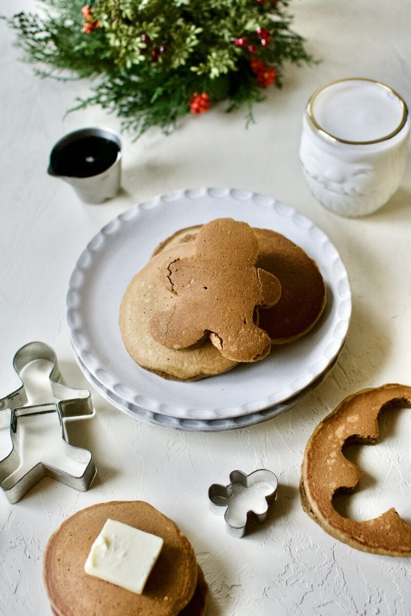 Gingerbread Pancakes stacked up and a gingerbread man cut out of one.