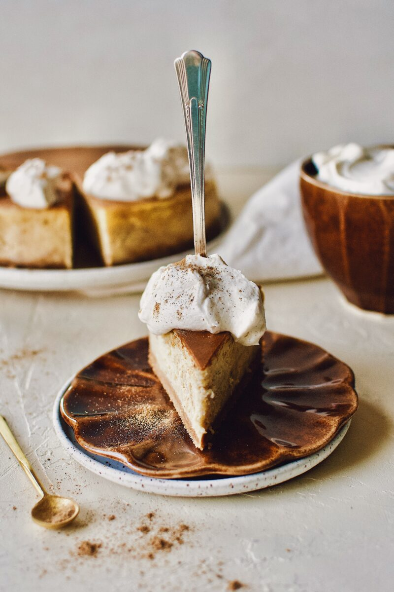 Chai-Spiced Cheesecake ready to eat with a fork pressed into it.