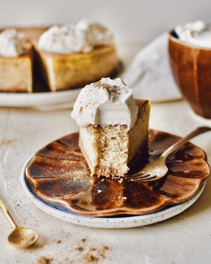 Chai-Spiced Cheesecake with a bite taken out of it.