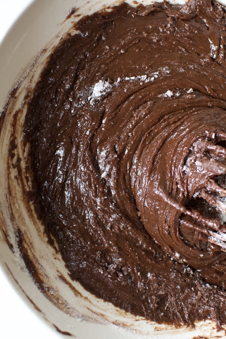 Whisking the flour into the classic brownie batter.