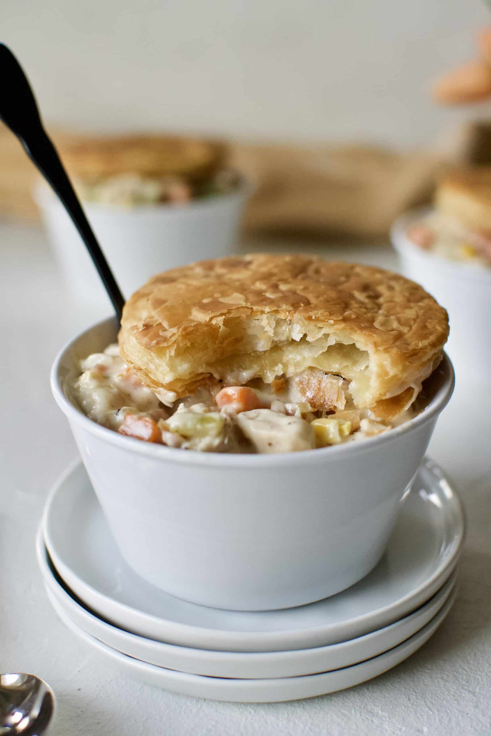 3 individual Chicken Pot Pie with Puff Pastry tops.