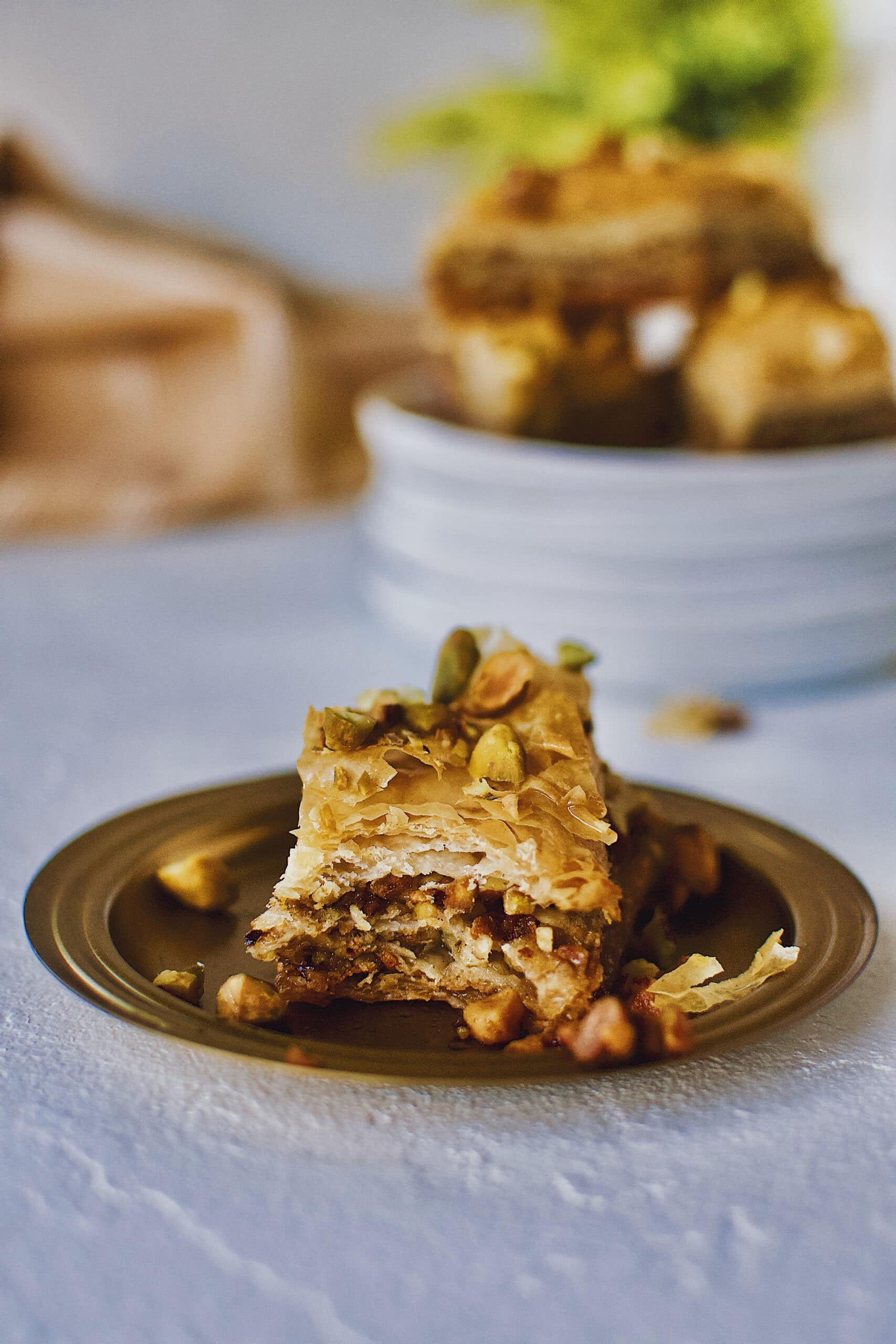 Joanna Gaines recipe for Baklava served right out of the baking dish on a gold plate.