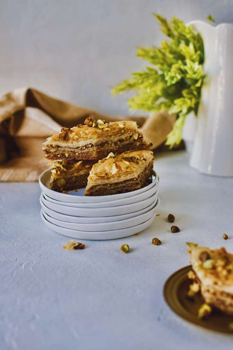 Joanna Gaines recipe for Baklava stacked on a white plate.
