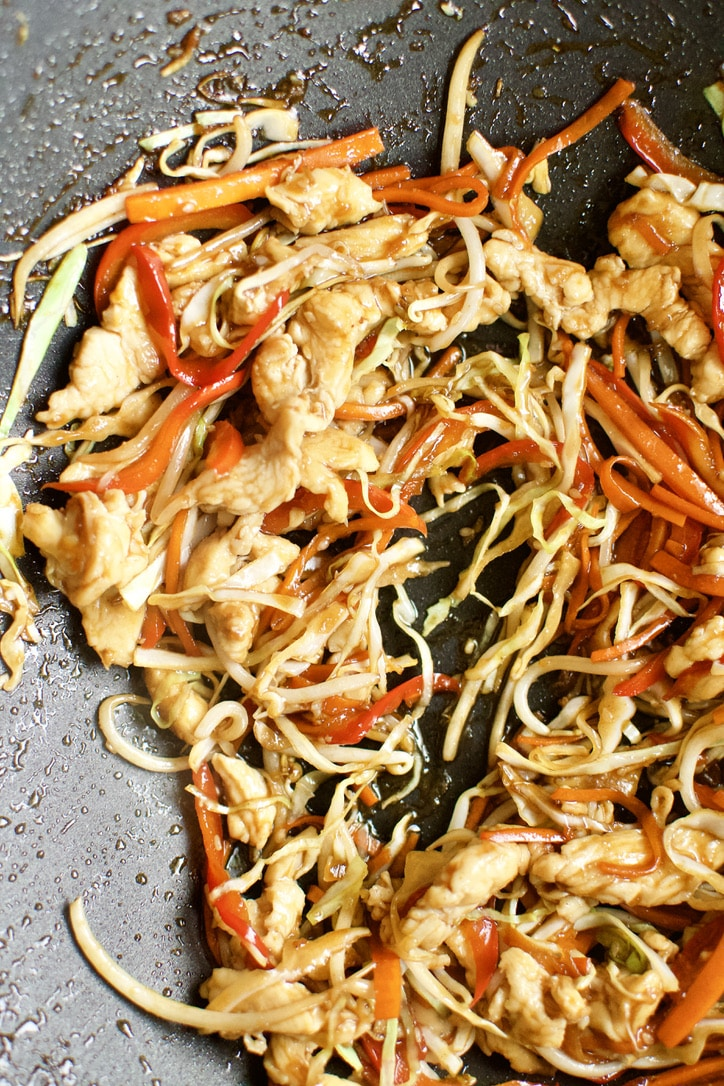 Chicken added back to the cooked vegetable in a super hot wok.