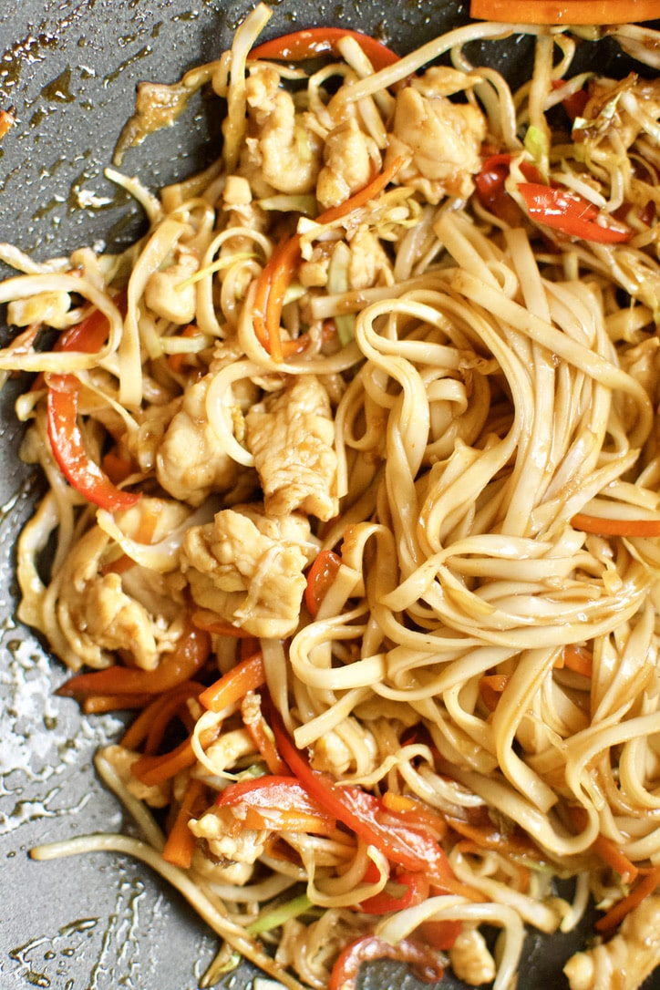 Noodles added to the chicken, veggies, and sauce to complete the dish of Chicken Lo Mein.