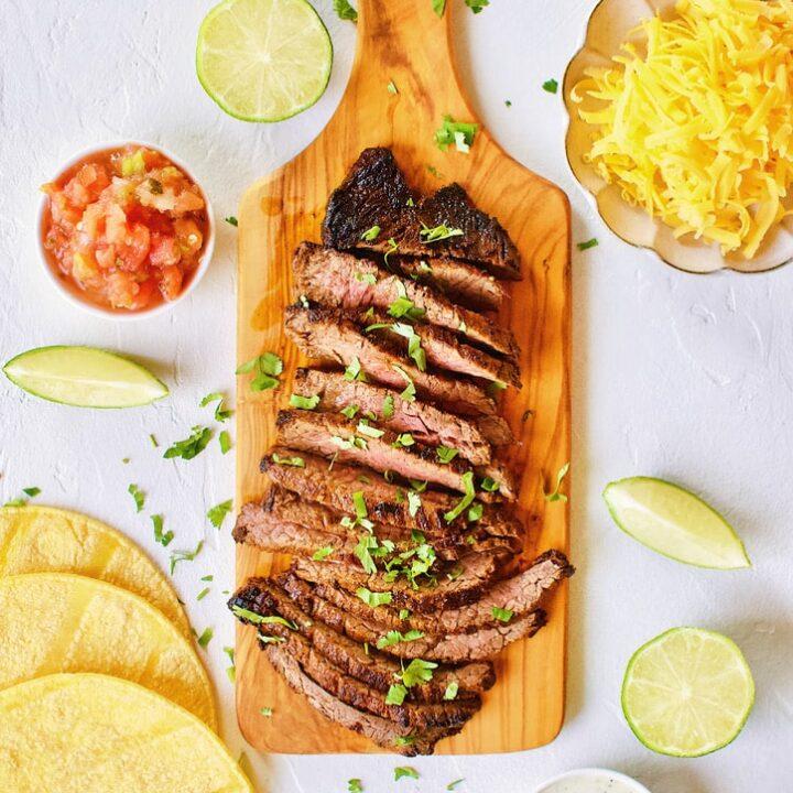 Carne Asada Fajita Steak on a chopping board.