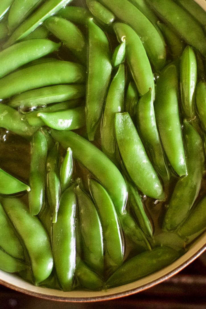 Sugar Snap Peas cooking in boiling water.