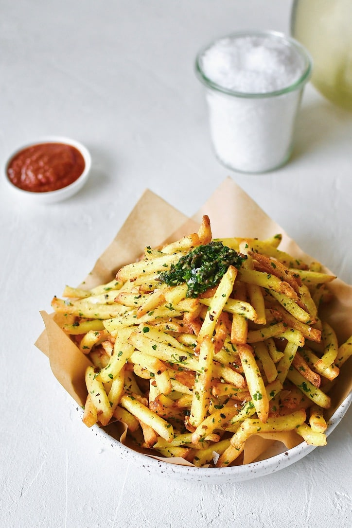 Baked French Fries tossed in truffle garlic paste.