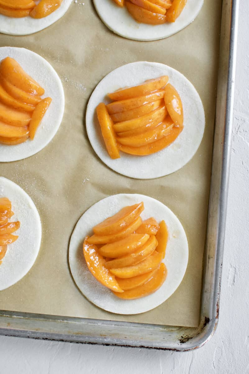 Pie crust rounds topped with apricot slices.
