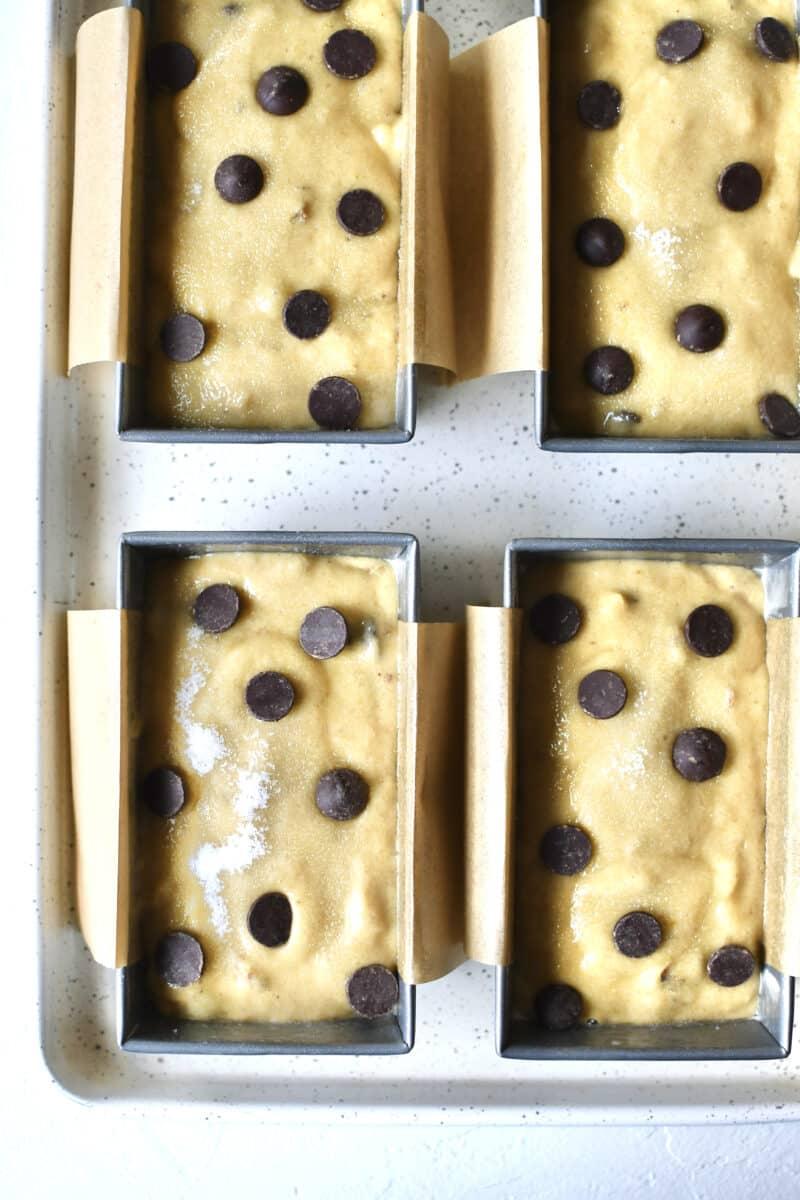 Banana bread batter in mini loaf pans.