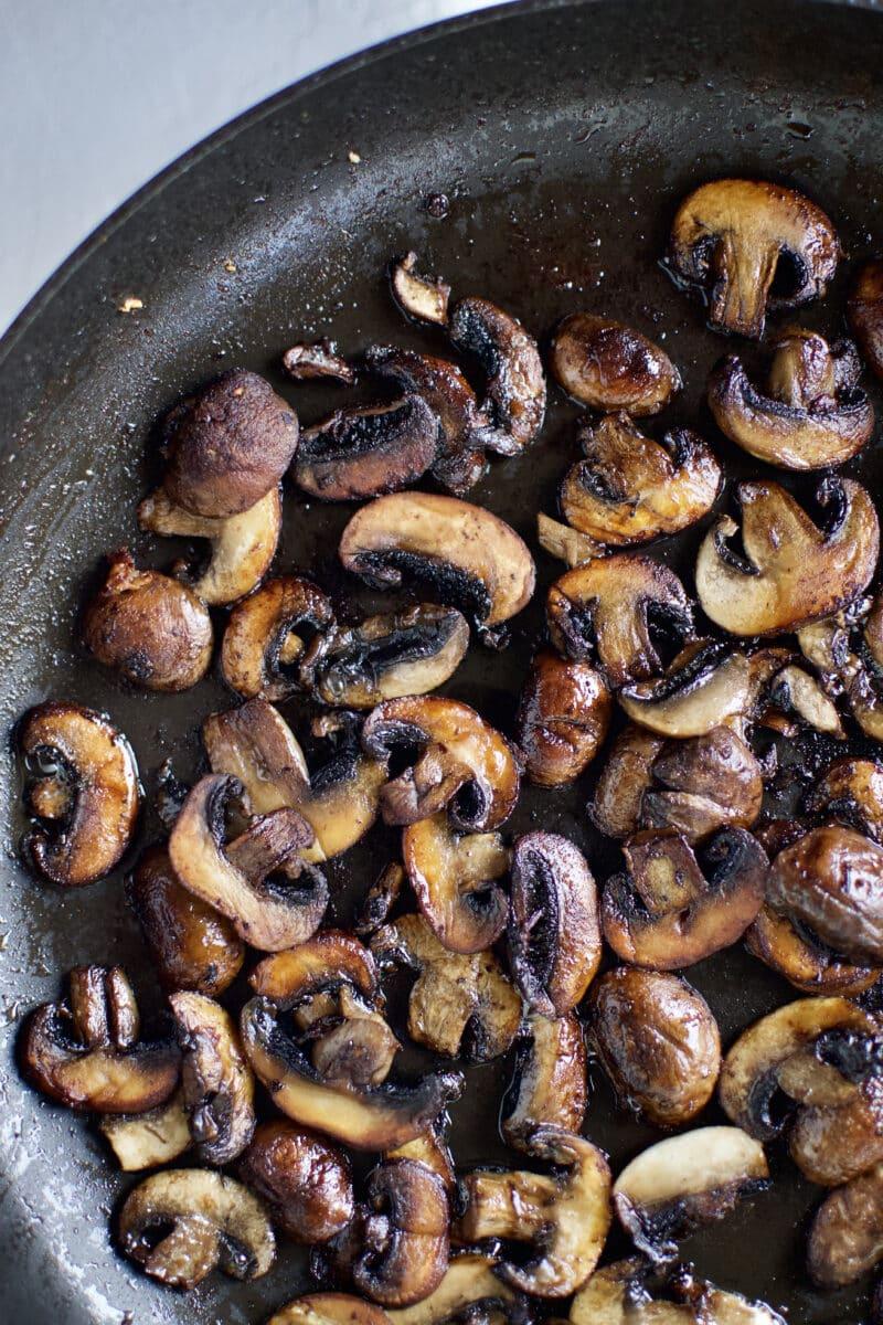 Browned mushrooms in a pan.