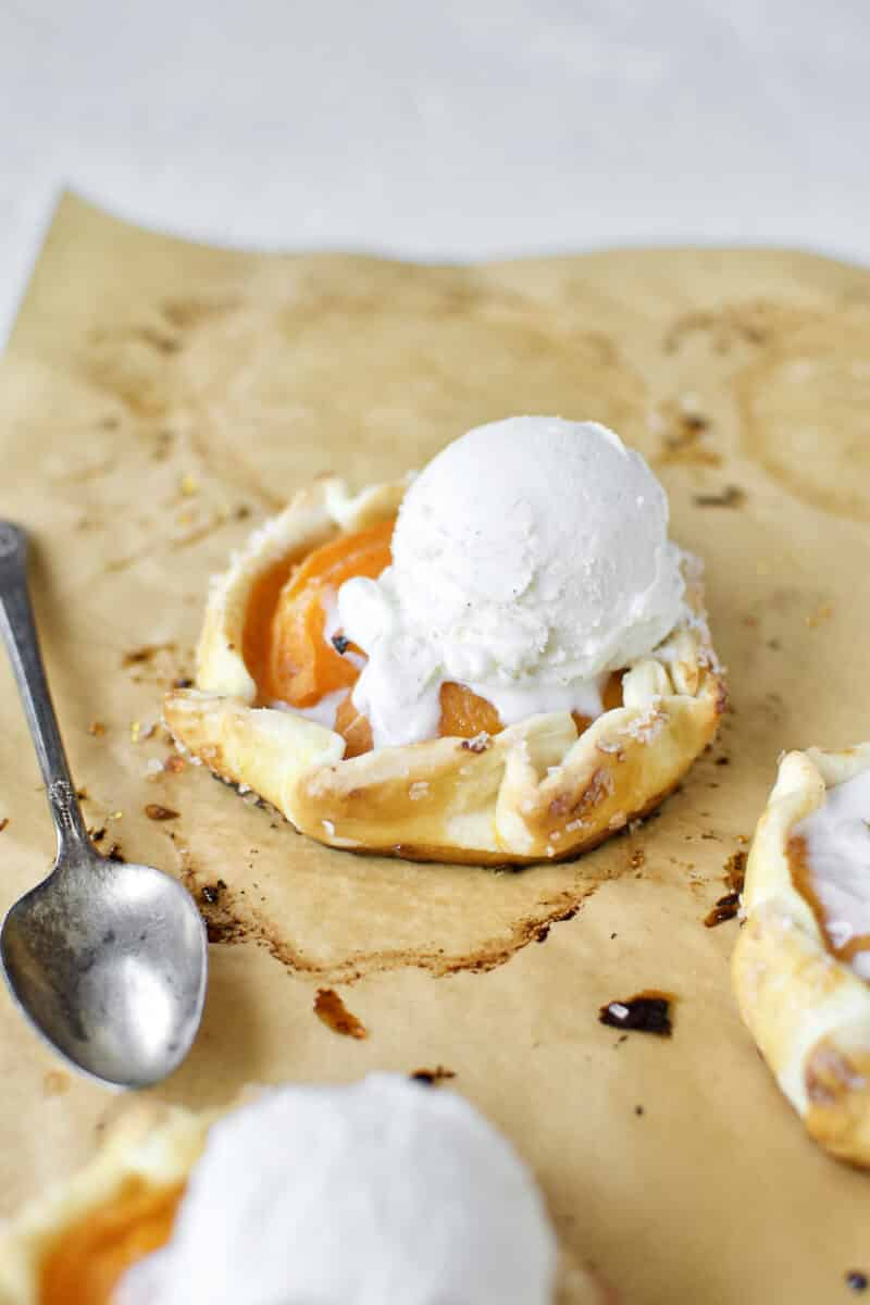 Apricot Pies fresh out of the oven, topped with vanilla ice cream.