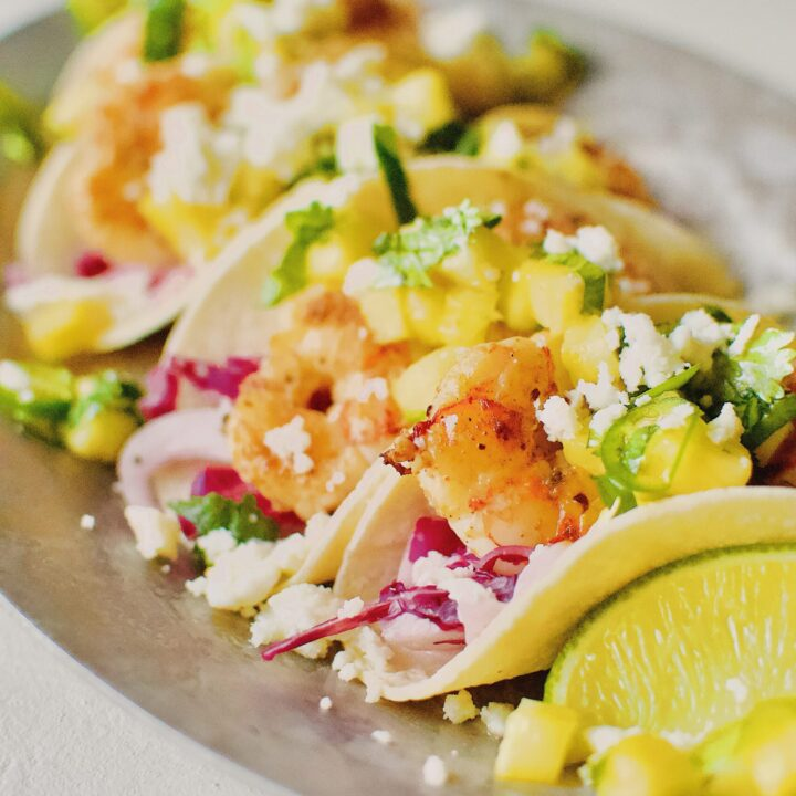 Baja Shrimp Tacos on a platter with all the toppings.