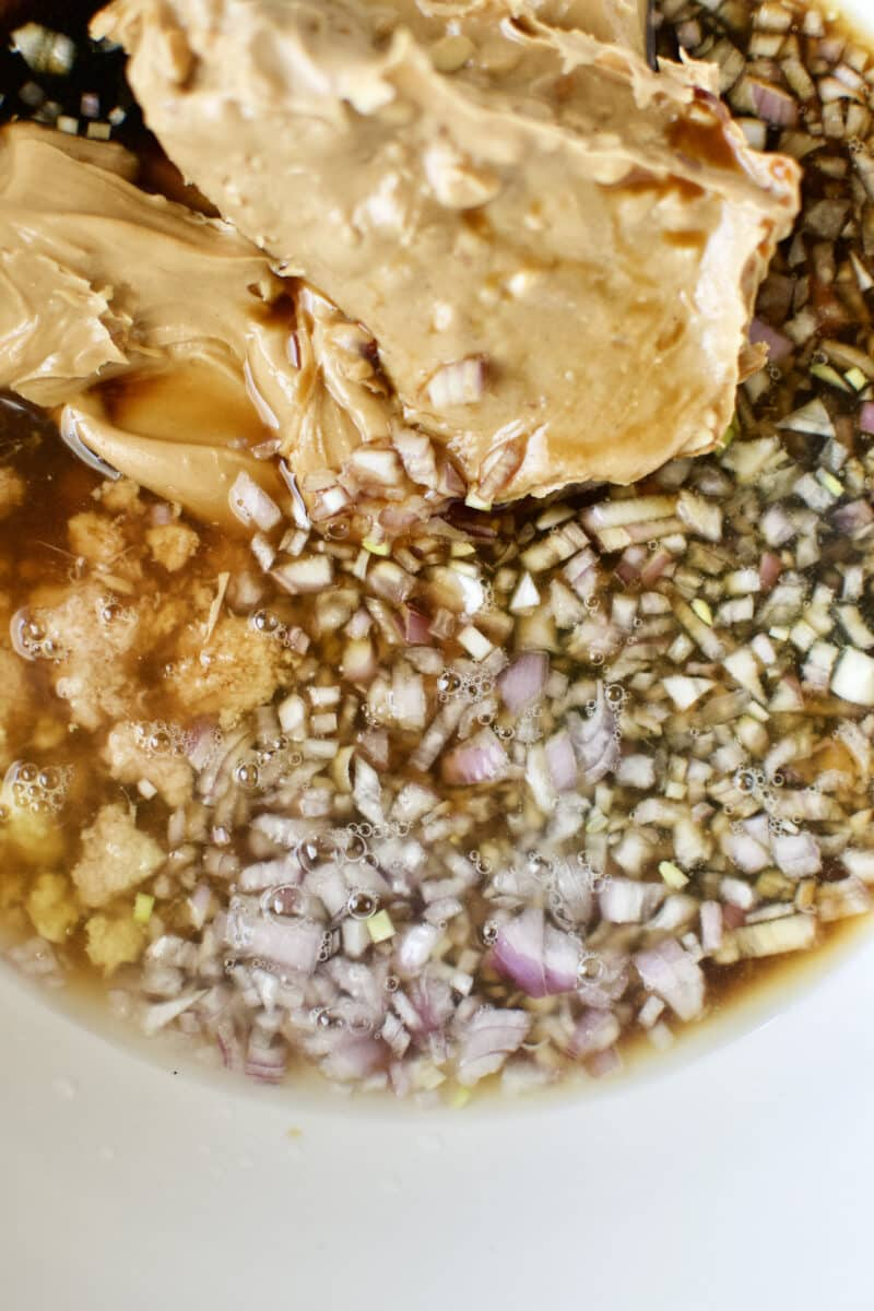Ingredients for peanut dressing in a bowl.