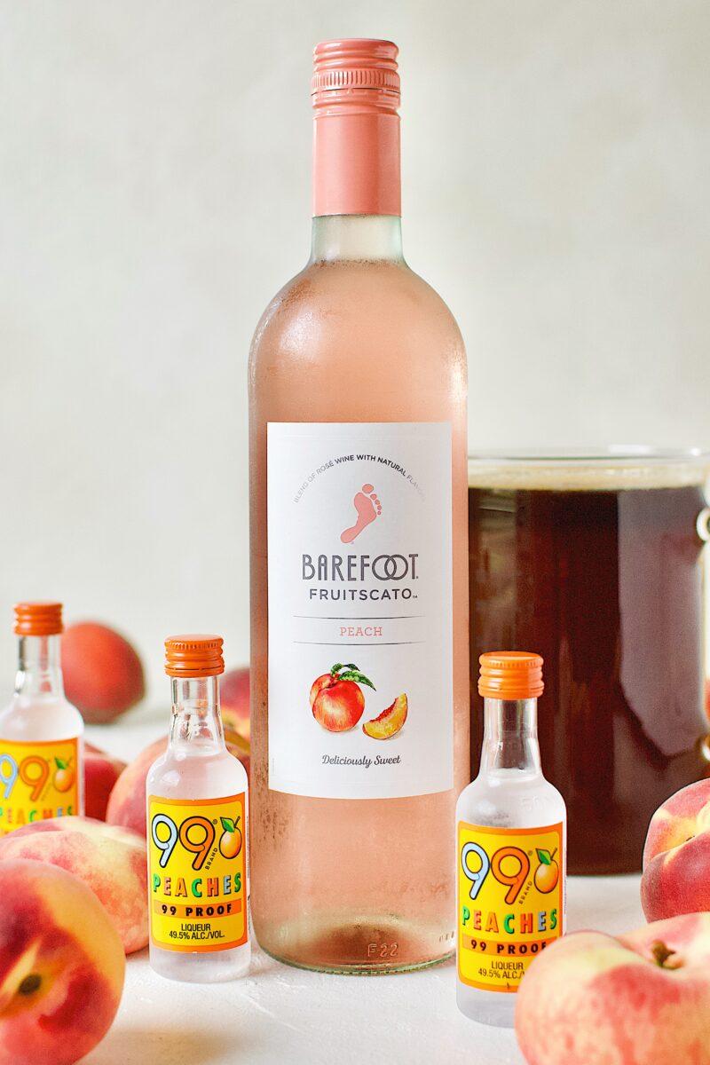 Ingredients needed to make Peach Sangria.