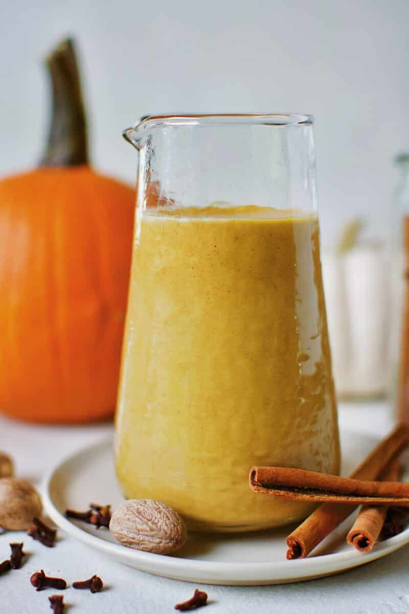 Sugar-Free Pumpkin Spice Syrup in a carafe ready for morning coffee to make a homemade Pumpkin Spice Latte.