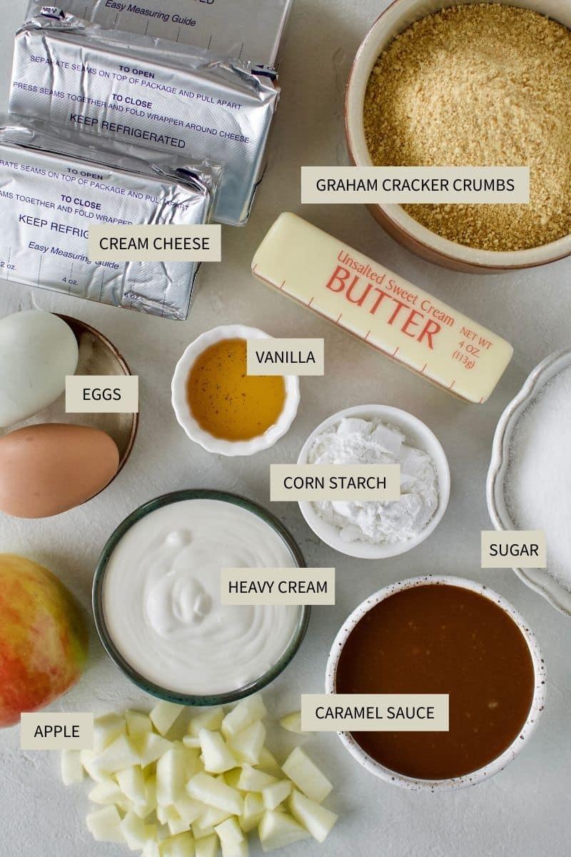 Ingredients needed to make Caramel Apple Crisp Cheesecake.