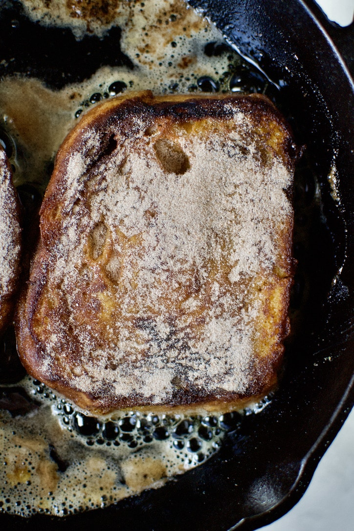 The first cooked sided of the french toast, after it's first flip. Coated in Cinnamon Sugar.