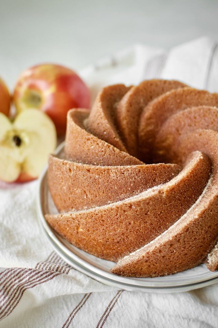 Apple Cider Donut Cake, after being brushed with cider syrup and dusted with spiced sugar.