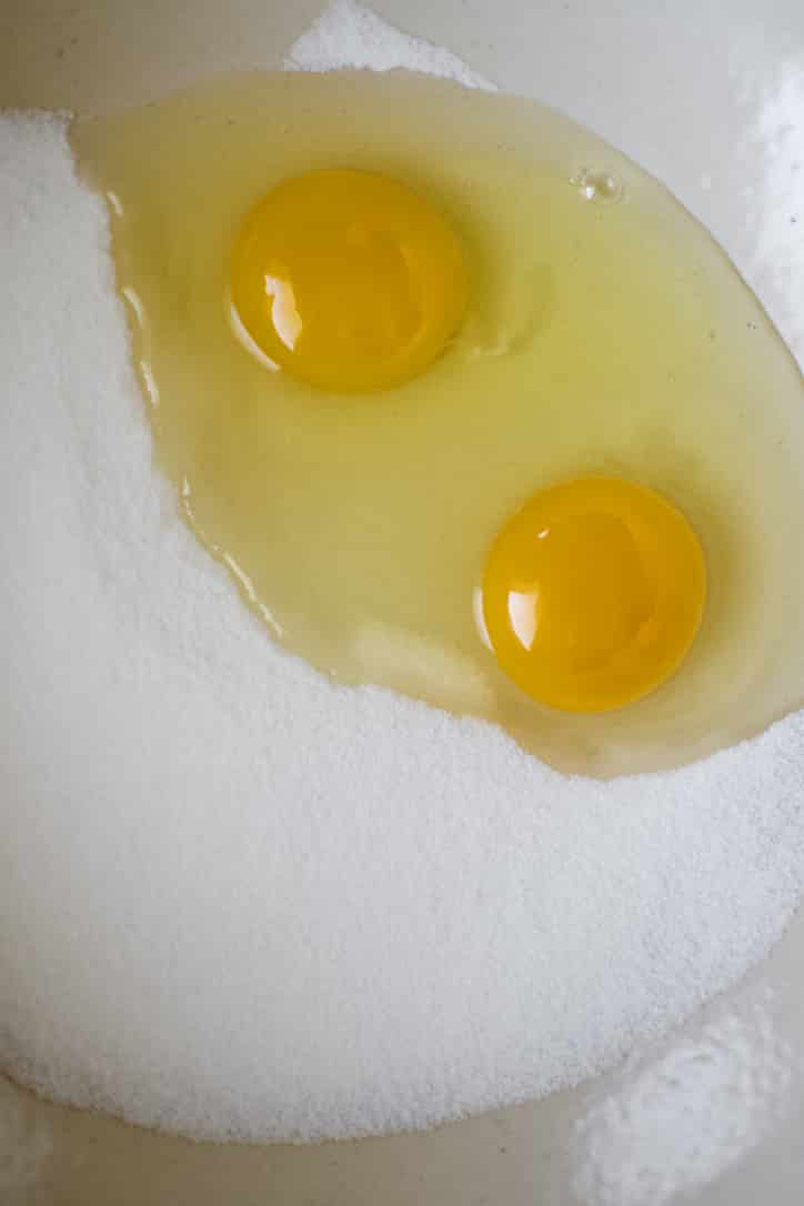Eggs and Sugar in a bowl ready to be whisked together until foamy.