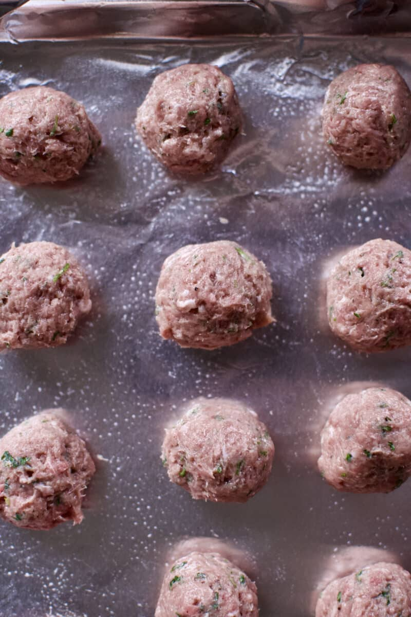 Rounded meatballs on a tray.