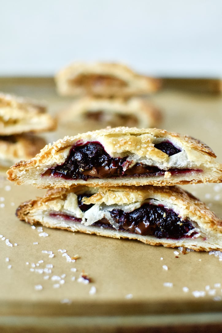 Boysenberry and Dark Chocolate Hand Pie. Sliced in half and ready to eat.